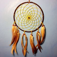 Brown faux suede trim dream catcher, gold yellow web, rooster feathers finish 15cm diameter dreamcatcher hand made on Etsy, £9.00