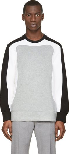 Neil Barrett Long sleeve pullover neoprene-effect sweatshirt in heather grey. Colorblock yoke and sleeves in black and white. Crewneck collar. Unlined. Tonal stitching.