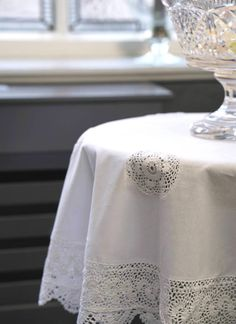 Cotton and Lace Tablecloth: These beautiful tablecloths take inspiration from Ireland's long and rich tradition of lace-making and crochet. They are made from cotton and feature delicate crochet detailing throughout. Lace Tablecloth Wedding, Crochet Tablecloth, Vintage Table Linens, Irish Wedding, Lace Making, White Aesthetic, Crochet Lace, Delicate, Table Decorations