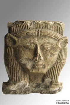 This stylized stone sculpture of goddess Hathor was the capital of a pillar. She is shown wearing a wig, with a human face and the ears of a cow. This work was most probably completed during the reign of Queen Hatshepsut, Dynasty 18.