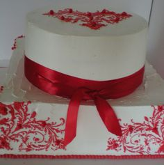 """Beautiful and delicate stencil work in a striking red highlighted their wedding cake set amid the trees of Ashlawn-Highland. They couldn't have had a more perfect day and I was happy that the red matched all the table decorations!! (Reds can be """"squi wedding dresses #weddingdress #weddingdresses See it here : http://www.amazon.com/gp/product/B002AVZ57K/ref=as_li_ss_tl?ie=UTF8=1789=390957=B002AVZ57K=as2=mantosuc-20"""