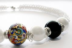 Pearl and onyx centered with a gorgeous Murano glass bead on hand coiled silver wire.