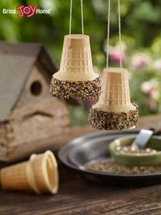 Best 12 Bird Feeder Cones Ingredients: Joy Ice Cream Cones Peanut Butter Knives and Plates Bird Seed String or Thin Wire Directions: Poke hole in the bottom of the cones Spread peanut butter along the top rim of the cone Roll the sticky peanut but Bird Crafts, Nature Crafts, Nature Nature, Bird Feeders For Kids To Make, Bird Feeder Craft, Bird Seed Feeders, Activities For Kids, Crafts For Kids, Outdoor Activities
