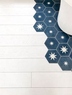 wooden flooring White wooden floor combined with blue star patterned hexagonal concrete tiles from MOSAIC Factorys CEMENT TILE collection SHAPES Floor Patterns, Star Patterns, Tile Patterns, Honeycomb Tile, Hexagon Tiles, White Wooden Floor, Concrete Tiles, Cement Tiles Bathroom, Concrete Floor