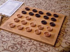 Handcrafted game of Alquerque from 1283. This is a wood board game with wood…