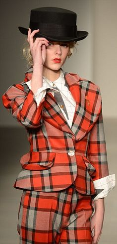A model in the autumn/winter 2014/2015 collection sports a tartan suit...