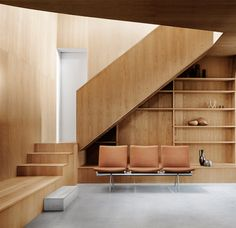 Simple panel enclosure for stair - note the same material as the cabinets below. Simple panel enclosure for stair - note the same material as the cabinets below. Houses Architecture, Interior Architecture, Interior Stairs, Interior And Exterior, Date Photo, Waiting Area, Ergonomic Chair, Lounge Seating, Wood Interiors