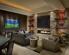 Another successful Transitional family room. Rustic stone, Modern shelving Contemporary fireplace and Classic furniture.