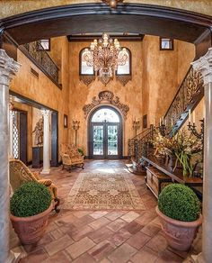 Stunning Foyer. I feel like I should be walking out the front door to see acres of vineyards on the Italian countryside.