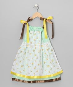 Layered with fancy, this darling dress features sweet knit embellishments and a matching overlay on the bodice and skirt. A cinched opening at the top and ties at the shoulders give it a comfy fit.100% cottonMachine wash; tumble dryMade in the USA