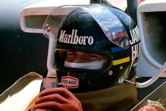 "James Hunt lid. The opening theses days is now bigger. Fire protection ""skirt"" around the bottom of the helment and fireproof face mask."