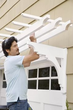 Use milled brackets and pressure-treated lumber to create an elegant canopy over your garage door Garage Trellis, Garage Pergola, Garage Shed, Garage House, House Front, Garage Doors, Garage Exterior, Garage Door Design, House Paint Exterior