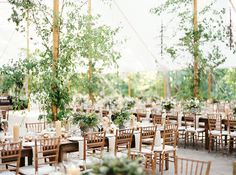 This a picture of a wedding done at Clifton Inn last summer. I like the greenery wrapped around the support poles-incorporating lighting there might be really pretty as well...