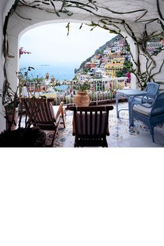 Le Sirenuse sits high on a cliff above the Amalfi Coast town of Positano, a place where you'll find crystal-clear shores, the best spaghetti alle vongole in the world – and very colourful buildings. This view is perfection; all it needs is for you to sit back, put your feet up and sip on your Campari soda. Le Sirenuse, sirenuse.it.   - HarpersBAZAAR.com