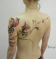 Watercolor chrysanthemum tattoo - This cool tattoo extend from your arm to your back but with cool subtlety you only see on watercolor paintings. Placing it on your arm can make you show off your beautiful tattoo but the extension would make it look like you have more to showcase. If you're a fan of watercolor paints, then you'll definitely enjoy this.