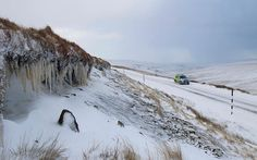 A police vehicle passes by on the B6277 road in the severe and dangerous weather conditions on this high Pennine road  Picture: Jim Nicholson / Alamy  12/11/14