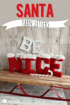 Cardboard letters wrapped in yarn, topped with craft fur, and painted red with craft paint