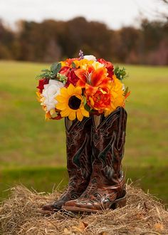 you have to have boots with a country fall wedding! wheat inside instead of flowers, and indian corn in front.