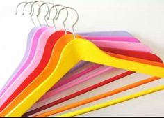 Set of 6 Hand Painted Wooden Hangers: Colours - Yellow, Orange, Red , Pink, Rani Pink, Aqua Blue (Pastel shades)  • Hand painted Solid wood construction hanger to hold your heaviest clothes • Coated with matt Finish to avoid any cloth slipping