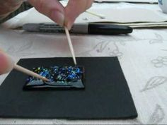 Video tutorial outlining how to make faux gems using resin.