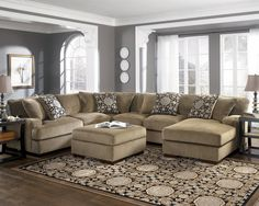 Furnish your home with this warm piece from Grenada-Mocha. Contemporary in design, with oversized set-back arms and slightly exposed block feet, this contemporary sectional collection will look great in any room while providing plenty of seating for your family and friends. Give yourself extra room to lay down and relax with the optional right-arm-facing chaise, otherwise kick back and put your feet up on the matching square ottoman to really relax and feel at home.