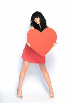 I love her! She's pretty! Her songs are amazing! And she is really awesome live in concert!