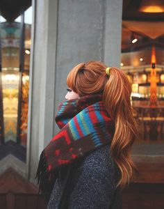 long pony tail..wouldn't mind the scarf either..