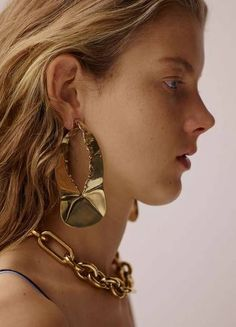 Extra large earrings were spotted all over the spring 2017 runways and we honestly can't get enough of oversized hoops, hinged geometric earrings and single abstract shapes. Tuck that hair behind your ears, ladies. Statement earrings are bigger and badder than ever!