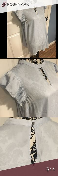 Cinderella Blue Sheer Top Pictures do not really show the pretty blue of this top. Never worn. Pretty Cinderella blue top with ruffle at shoulders. Buttons at the back of the neck. Mossimo Supply Co Tops Blouses