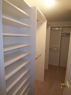 A narrow walk in closet with a door that opens in, can limit space, but keeping the hanging items on the back wall and corner help make the most of the space. Shoe shelves by the door help you keep them organized, last on in the morning, first off in the evening.