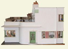 "Fabulous Art Deco doll house (modern recreation of a vintage 1930s design). ""The house is 36"" wide by 27"" long, 21"" high on two stories and 10"" high one story and is filled with the details that personified the Art Deco period. """