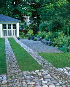 Driveway - Simple Stonework To keep the squares tidy, Roger Griffith edged them with shallow, V-shaped trenches that prevent grass roots from crossing over.