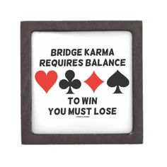 "Bridge Karma Requires Balance To Win You Must Lose Premium Keepsake Boxes #bridgekarma #requiresbalance #towinyoumustlose #fourcardsuits #bridgeplayer #acbl #duplicatebridge #humor #bridgesaying #wordsandunwords #karma  Gift box for any bridge player featuring the four card suits along with the following bridge saying: ""Bridge Karma Requires Balance To Win You Must Lose""."