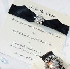 Satin save the date card with vintage style embellishment
