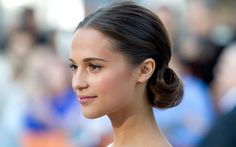 """Cast member Alicia Vikander arrives for the premiere of the film """"The Fifth Estate"""" at the 38th Toronto International Film Festival in Toronto September 5, 2013."""