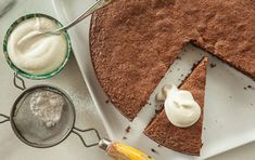 This rich, dense and very chocolaty cake gets a flavor hit from a topping of bay-leaf-infused whipped cream.