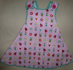 One pattern piece--that's it! pattern: Reversible Sundress by Sew Baby; fabric: Alphabet Soup by Riley Blake