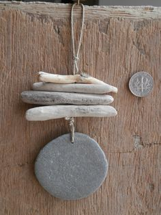 Handmade beach decor 'Driftwood Danglers' with huge flat beach English beach pebble.use for wind chime Driftwood Jewelry, Driftwood Projects, Driftwood Art, Beach Crafts, Diy And Crafts, Arts And Crafts, Driftwood Mobile, Nature Crafts, Pebble Art