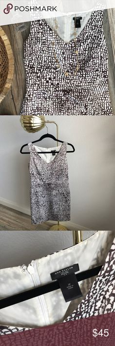 👗Ann Taylor vneck dress So pretty and perfect! 100% polyester so it feels amazing on! Vneck cut that emphasizes your best features! Pretty brown-Mauve tones on off white/ivory. Only flaw is it is missing the clasp on the back (please see picture). It has a perfect zipper in back though ☺️ I provided the stock photo so you can see the fit and style on! Ann Taylor Dresses Midi