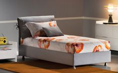 """""""Nathalie"""" Bed with removable cover. Also available as storage bed. Design by Vico Magistretti. Various fabric options available. Flou SoHo at 42 Greene Street, NYC."""