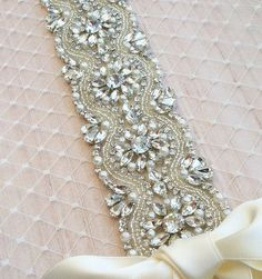 STUNNING **Swarovski Pearl and Rhinestone Sash full of gorgeous rhinestones and pearls.    Details:  -Pearl & Rhinestones measure: 2 at the widest