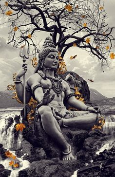 Shiva, husband of Parvati, father of Ganesha. Demon slayer, patron god of the Arts. Some of his attributes are his Third Eye, the snake Vasuki around his neck (who assisted in the churning of the ocean of milk), the crescent moon, the trishula (trident), the damaru (drum) and the Ganges river flowing through his hair.  Shiva is usually depicted facing the south. Kālī is represented as the consort of Lord Shiva, on whose body she is often seen standing or dancing.