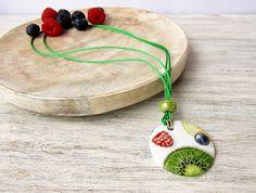 Necklace with porcelain pendant hand painted with kiwi and berries, bijoux porcelain jewelry, ceramic pendant, ceramics fruit salad bijoux by LaTavolozzaShop on Etsy