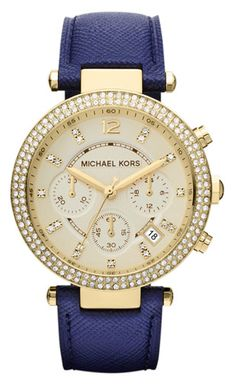 Stay on time and at the height of fashion with this Michael Kors Parker leather watch for women. This fetching watch features a goldtone and navy color scheme that elevates it from the ordinary. With