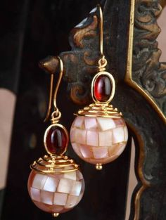 Gehna offer to sell Indo-western earrings handcrafted in 18k gold feature exquisite mother of pearl mosaic beads teamed with cabochon garnets online in Chennai.