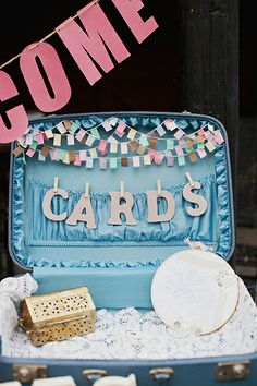A suitcase to put cards in? Plus some little flags? Yes, please!