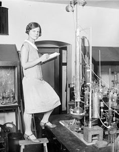 This gal is styling in a lab full of synthesis equipment