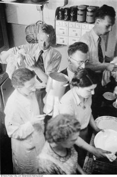 Ten Boom family - Eusie, with glasses (a Jew in hiding at the Beje) actually helping in the kitchen - Betsie is on the left.