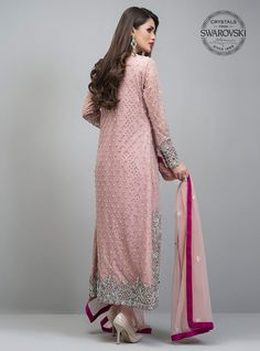 Embrace a timeless style with our net rose gold front open shirt. Blooming with silver kora dabka, pearls and Swarovski crystals, this outfit is artfully coordiNAted with fuchsia pants adorned with beautiful motifs at the bottom. Pakistani Party Wear, Pakistani Bridal Dresses, Pakistani Dress Design, Pakistani Designers, Pakistani Outfits, Indian Dresses, Indian Outfits, Shadi Dresses, Emo Outfits