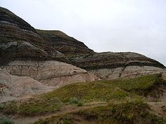 Badlands near Drumheller, Alberta, where glacial and post-glacial erosion have exposed the K-Pg boundary.